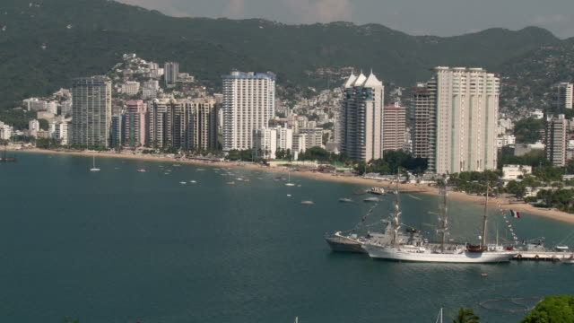 WS HA Acapulco Bay with School Mexican Navy Ship and hotels / Acapulco, Guerrero, Mexico