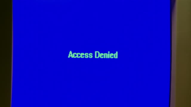 cu zo 'access denied' on computer screen/ ms computer on table under overhead light as man in suit taps baseball bat in his hand  - accessibility stock videos & royalty-free footage