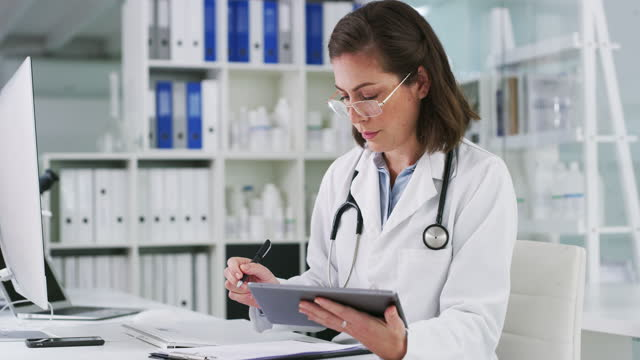 accessing a few of her latest healthcare reports - female doctor stock videos & royalty-free footage