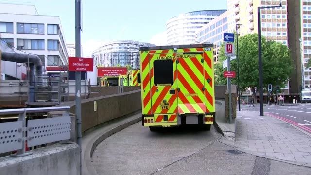 nhs accident and emergency waiting time targets not met england london st thomas' hospital ext ambulance up ramp to entrance of accident and... - stretcher stock videos and b-roll footage