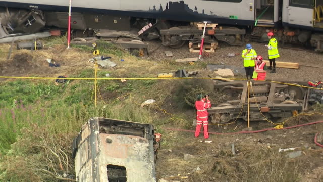 accident and network rail investigators at the wreckage of the train crash near stonehaven, aberdeenshire - compartment stock videos & royalty-free footage