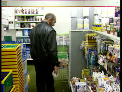 london kim howells mp interviewed sot we've got to try and learn man picking up roll of tape from shelf then along in diy shop vox pops diy... - workbench stock videos & royalty-free footage