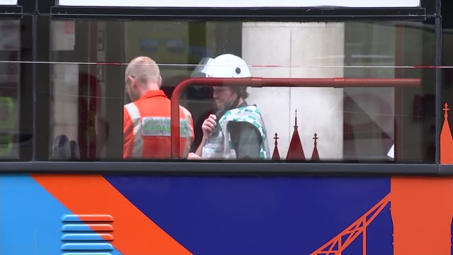 london tourist bus has roof ripped off after hitting tree england london bloomsbury various of golden tours london tourist bus with roof ripped off... - golden roof stock videos and b-roll footage