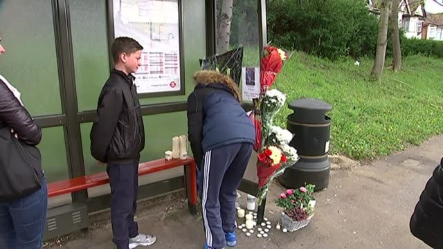 two people killed in motorbike accident in north east london; england: north east london; ilford: ext bv man laying flowers at temporary shrine for... - ilford stock videos & royalty-free footage