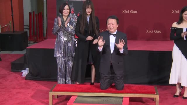 Acclaimed Chinese Director Xixi Gao is immortalized as his handprints and footprints are cast in cement at the TCL Chinese Theatre in Hollywood