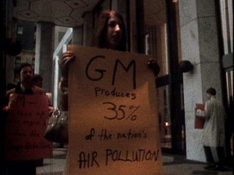 accompanied by nyu law students, consumer affairs advocate nader joins in protests outside of the general motors building to speak out against the... - general motors stock videos & royalty-free footage