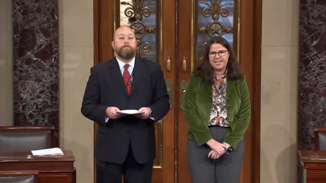 Accompanied by Senate majority staff Laura Dove House Reading Clerk Joe Novotny reports the fiscal 2015 spending package to the Senate Majority...