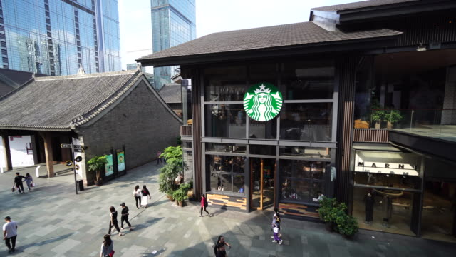 vídeos de stock, filmes e b-roll de according to starbucks financial report of the third quarter in 2018 it suffered the first decline on chinese market in nine years - starbucks