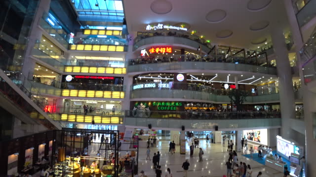 according to the chinese national bureau of statistics, the total sales of retail consumer goods in april reached 2.73 trillion yuan with an increase... - kaufhaus stock-videos und b-roll-filmmaterial