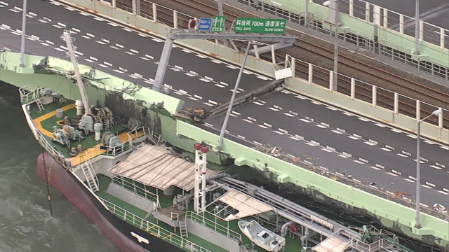 according to the regional headquarters of the japan coast guard a tanker smashed into an access bridge to the airport at 132 pm the bridge has a road... - typhoon stock videos and b-roll footage