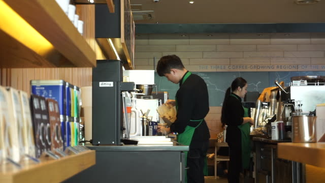according to the secondquarter financial report of starbucks issued at the end of april china's market maintained success with a comparable sales... - barista stock-videos und b-roll-filmmaterial