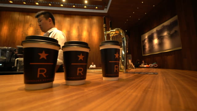 vídeos de stock, filmes e b-roll de according to the secondquarter financial report of starbucks issued at the end of april china's market maintained success with a comparable sales... - starbucks