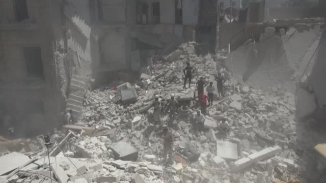 according to the syrian observatory for human rights at least six civilians were killed monday in aleppo city in barrel bomb strikes conducted by... - mashhad stock videos & royalty-free footage