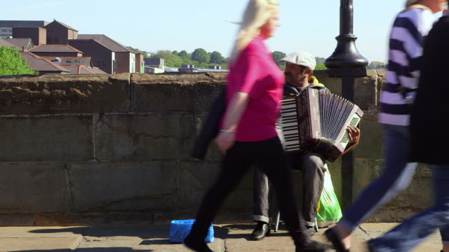 accordion playing street performer durham england - gratuity stock videos & royalty-free footage