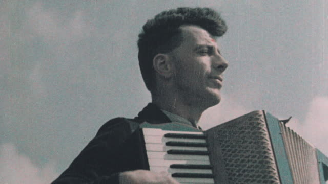 1937 montage accordionist playing his instrument outdoors / st austell, england, united kingdom - 1937 stock videos & royalty-free footage