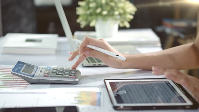 accountant woman is working budget finance data in afternoon - financial advisor stock videos & royalty-free footage