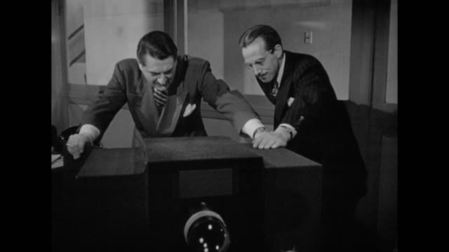 1948 Accusations are made when a client sees his stolen projector