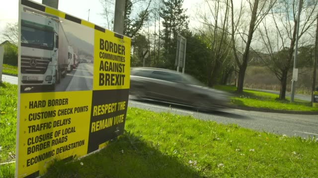 dup accuse sinn fein of holding northern ireland to ransom with red lines t06041704 / sign 'border communities against brexit' at roadside close shot... - sinn fein stock videos & royalty-free footage