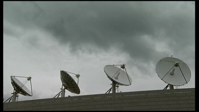 gchq accused of using american computer system to gather information on british citizens t07061301 / tx satellite dishes mounted on rooftop of... - google brand name stock videos and b-roll footage