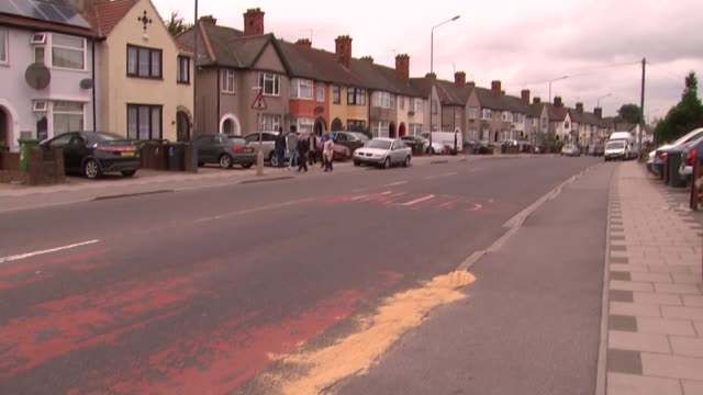 government to review sentences; dagenham: various of sand in gutter after acid attack on man riding moped fire brigade tape attached to wheelie bin - sidewalk gutter stock videos & royalty-free footage