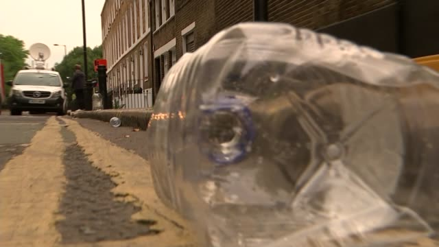 Government to review sentences ENGLAND London EXT Various of empty water bottles at roadside following recent acid attacks