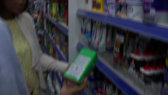 Retailers sign up to voluntary ban on sales to under 18s R170717009 / ENGLAND London INT Shelves in shop and looking at products containing acid...