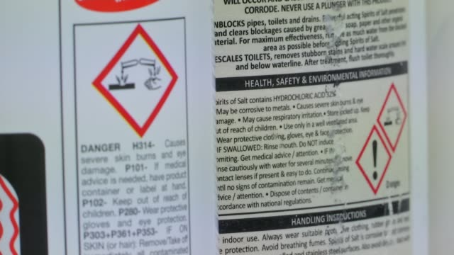 Retailers sign up to voluntary ban on selling corrosive substances to under18s R170717009 London INT Close shot of 'corrosive' warning signs on acid...