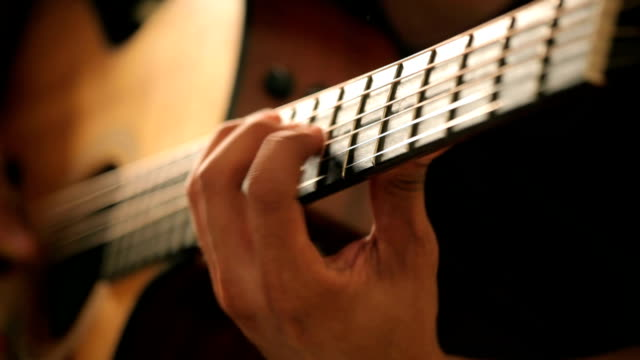 acoustic guitar in musician hands - plucking an instrument stock videos and b-roll footage