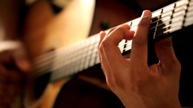 acoustic guitar in musician hands - guitarist stock videos & royalty-free footage