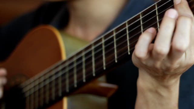 acoustic guitar in musician hands - fretboard stock videos & royalty-free footage