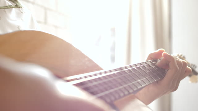 acoustic guitar in musician hands - guitar stock videos & royalty-free footage