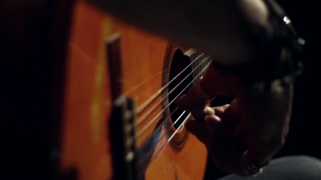 acoustic guitar spanish flamenco style finger picking - close up - flamenco stock-videos und b-roll-filmmaterial