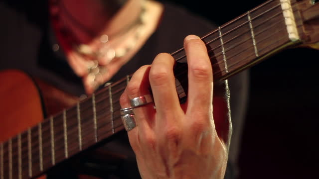 acoustic guitarist playing guitar - classical nylon string - close up - musikstil stock-videos und b-roll-filmmaterial