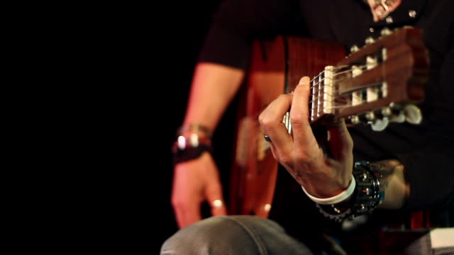 acoustic guitarist playing guitar - classical nylon string - flamenco stock videos & royalty-free footage