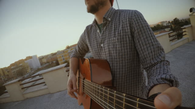 acoustic guitarist playing guitar outside - musical instrument stock videos & royalty-free footage
