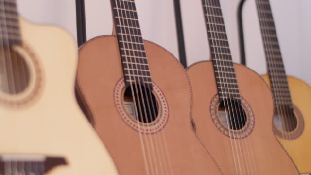 Acoustic guitars displayed in workshop