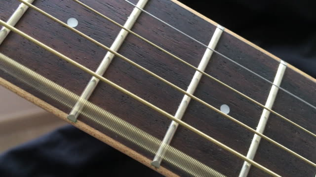 acoustic wooden guitar 6th string on fret board - string stock videos & royalty-free footage