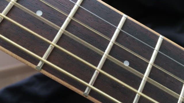 acoustic wooden guitar string playing on fretboard - string stock videos & royalty-free footage