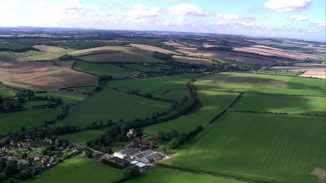 Acres of farmland create a patchwork across the countryside. Available in HD.