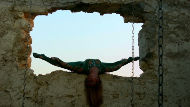 acrobat exercising in ruined window frame - window frame stock videos & royalty-free footage
