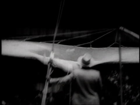 vidéos et rushes de acrobat jumping from platform into net at circus in madison square garden / new york, usa - 1957