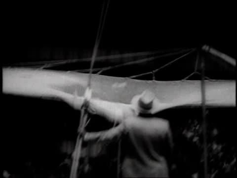 vídeos de stock e filmes b-roll de acrobat jumping from platform into net at circus in madison square garden / new york, usa - 1957