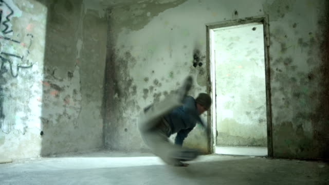 hd: acrobatic breakdancer kicking dust - modern dancing stock videos and b-roll footage