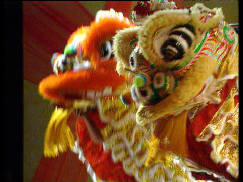 acrobatic chinese dragon dance in hong kong for chinese new year; 1990's - drache stock-videos und b-roll-filmmaterial