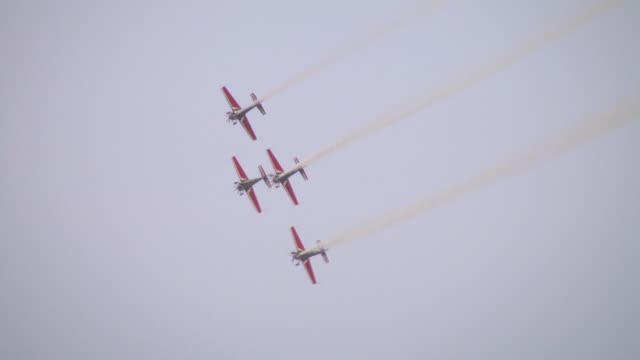 acrobatic planes of jordanian air forces stage a show during a special ceremony organized to celebrate 69th anniversary of jordan's independence from... - acrobatic activity stock videos and b-roll footage