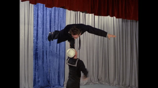 acrobats dressed as sailors and in a gorilla suit perform - fast motion - performing arts event stock videos and b-roll footage