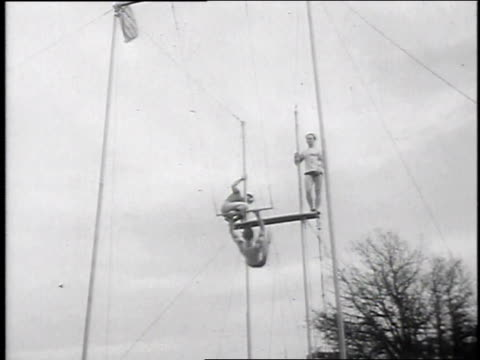 1947 montage acrobats on trapeze, cameraman in net / philadelphia, pennsylvania, united states - netting stock videos and b-roll footage