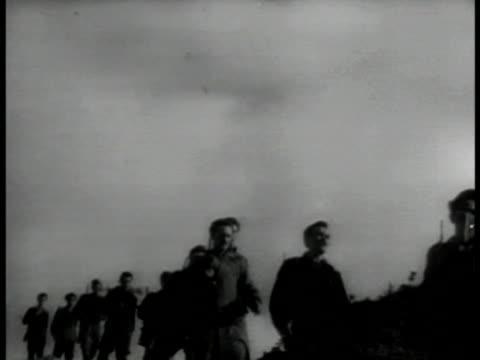 vidéos et rushes de acropolis city. vs greek soldiers walking on hill, through village. vs mountains, guerrilla villages. vs greek army firing artillery , explosions on... - guerre civile