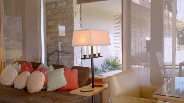 vídeos y material grabado en eventos de stock de ds across 1950s style living room with original furniture in mid-century modern home - palace room