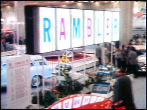 right across a section of the amc display at the 1959 chicago auto show ramblers and ambassadors are visible throughout the display / ws ground level... - 1959 stock videos & royalty-free footage